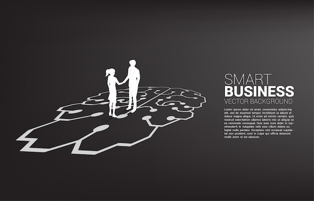 Siluetta della stretta di mano della donna di affari e dell'uomo d'affari sul grafico del cervello. concetto di partenariato del lavoro di gruppo e strategia di cooperazione.