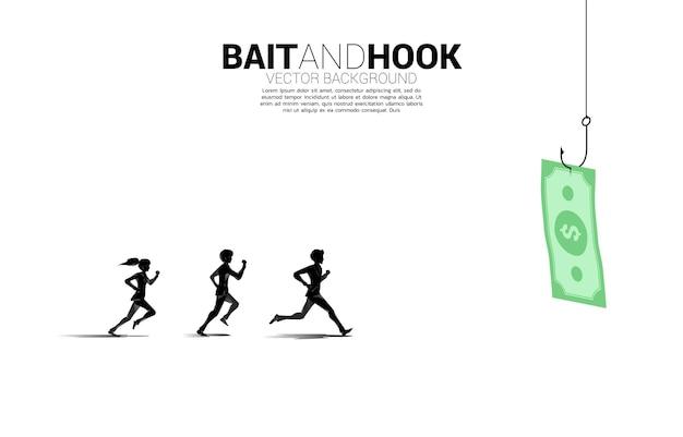 La siluetta dell'uomo d'affari e della donna d'affari in esecuzione segue la banconota con l'amo da pesca. concetto di esca e gancio nel mondo degli affari.