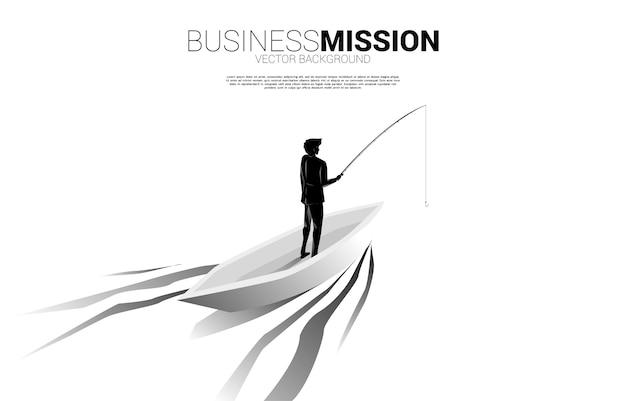 Silhouette di uomo d'affari pesca in piccola barca concetto di targeting e esche nel mondo degli affari