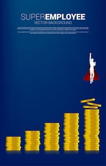 Siluetta dell'uomo d'affari che vola dalla colonna più alta della pila di monete del grafico. concetto di spinta e crescita nel business.