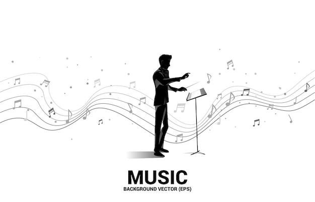 Silhouette del direttore d'orchestra in piedi con una nota musicale volante.