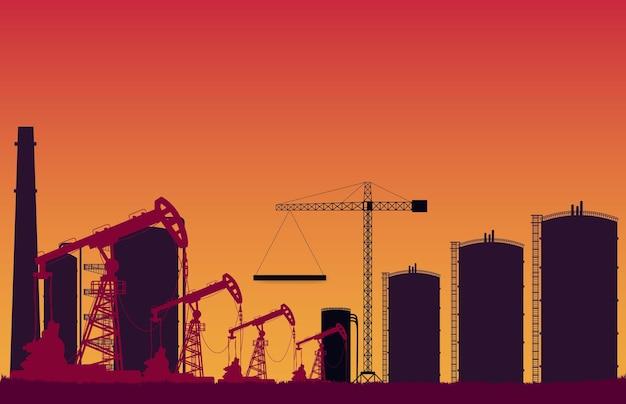 Silhouette stazione di pompaggio del petrolio greggio e cantiere del serbatoio su gradiente arancione