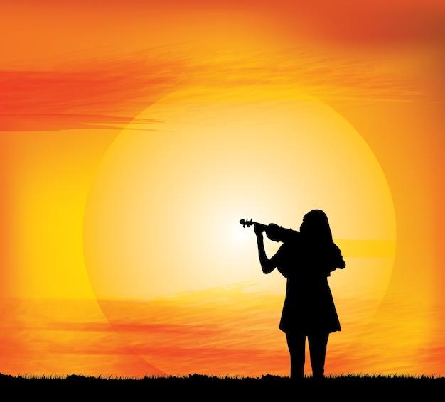 La siluetta della ragazza gioca il violino