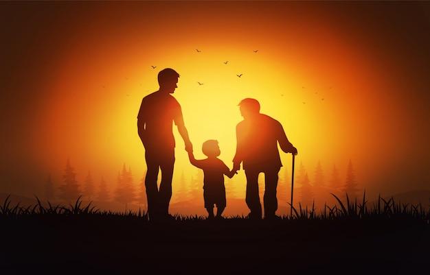 Siluetta del nonno, padre e figlio nel parco presso l'ora del tramonto