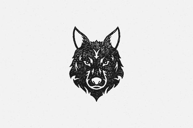 Siluetta della testa del lupo selvatico come effetto timbro disegnato a mano della fauna selvatica di simbolo