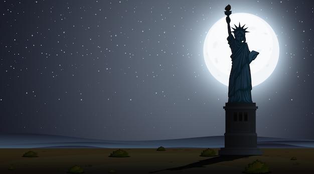 Profili la scena con la statua della libertà alla notte