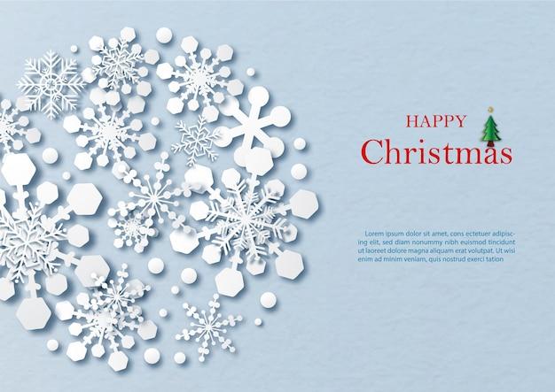 Modello di fiocchi di neve sagoma a forma di cerchio gigante e stile di taglio della carta con la dicitura del giorno di natale, testi di esempio su sfondo di carta blu.