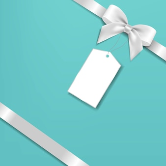 Fiocco d'argento e cartellino regalo