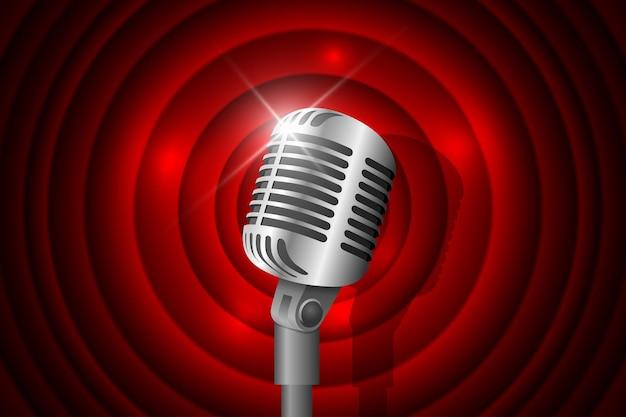 Microfono vintage in metallo argentato illuminato e sfondo cerchio rosso concetto di musica retrò microfono acceso