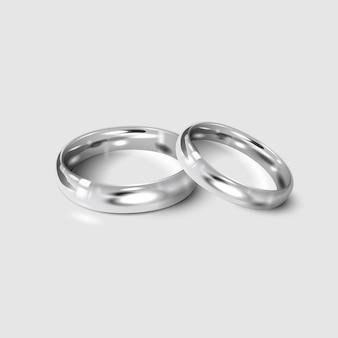 Anelli di nozze d'argento isolati su bianco. 3d realistico.