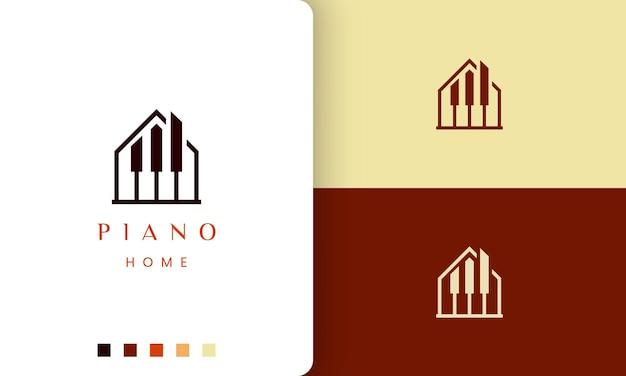 Logo o icona del compositore di pianoforte semplice e moderno a forma di casa