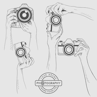 Schizzo della fotocamera in mano, illustrazione di fotografia