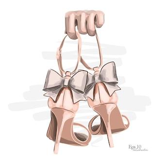 Schizzo disegnato a mano. scarpe in rosa, scarpe aperte con fiocco sul tallone.
