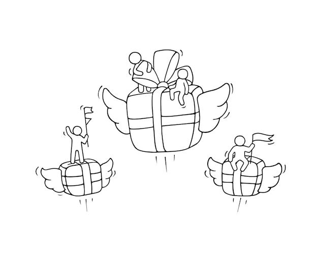 Schizzo di scatola regalo volante con piccoli lavoratori.