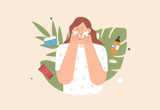Concetto di cura della pelle la giovane donna sveglia applica la crema e la pulizia o l'idratazione della sua pelle
