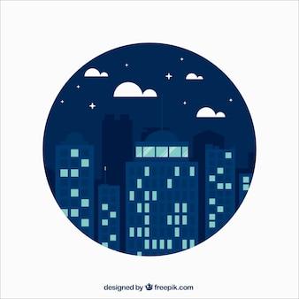 Grattacieli in una città di notte