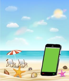 Smartphone schermo verde sulla spiaggia di sabbia di mare