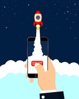 Smartphone con avvio a razzo, concetto di affari.