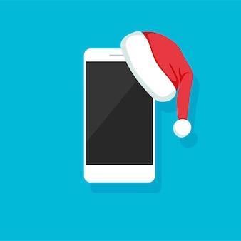 Smartphone con cappello di babbo natale telefono come un regalo per capodanno e modello di banner pronto per natale