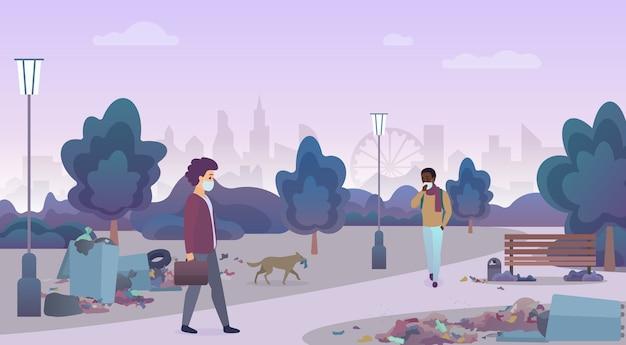 Annusare i rifiuti delle discariche con persone infelici mascherate in una strada svantaggiata della città