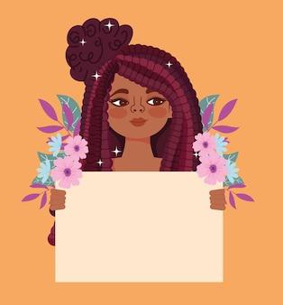 Bella ragazza sorridente con cartello e fiori