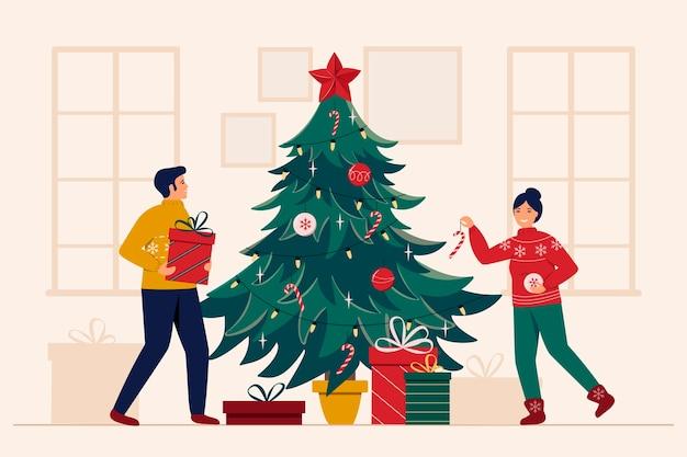 Uomo e donna sorridenti decorano l'albero di natale con giocattoli e ghirlande.