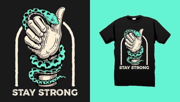 Disegno della maglietta della mano che morde il serpente