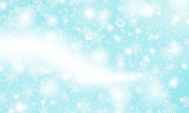 Sfondo di neve. nevicata invernale. fiocchi di neve bianchi su cielo blu.