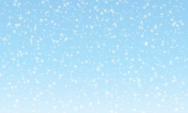 Modello di neve. fiocchi di neve bianchi su sfondo blu. neve che cade.