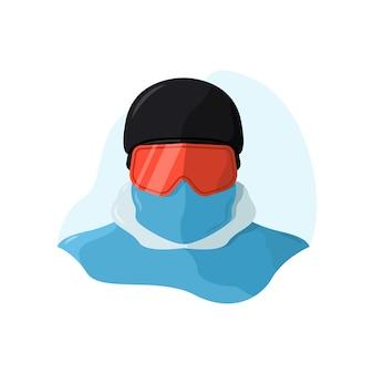 Snowboarder che indossa un casco e una maschera da snowboard