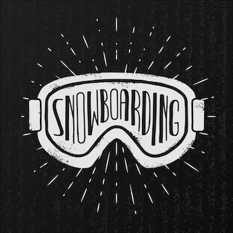 Sfondo di snowboard. occhiali e tipografia su sfondo nero vintage.