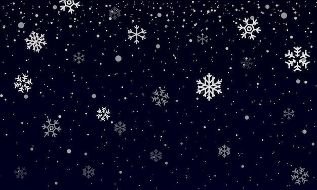 Nevicata. fiocchi di neve sul buio