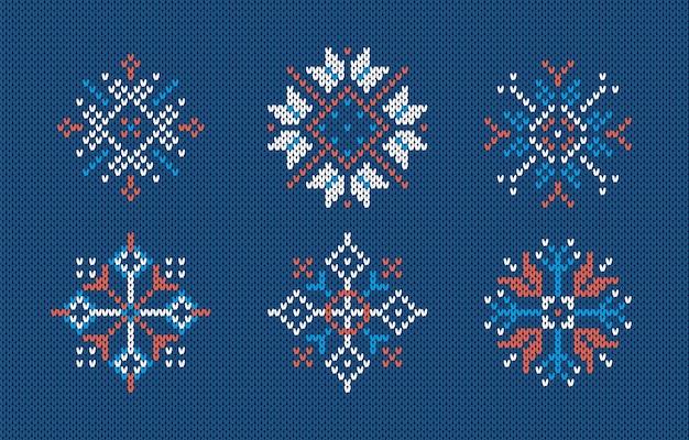 Fiocchi di neve sul motivo a maglia. illustrazione vettoriale. sfondo blu senza soluzione di continuità. trama a maglia maglione