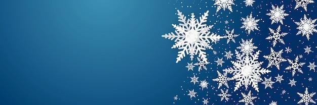 Modello di lusso fiocchi di neve su sfondo blu. design moderno per materiale di sfondo di natale, inverno o capodanno, decorazione astratta del fiocco di neve per biglietto di auguri, banner di vendita