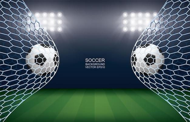 Pallone da calcio in porta. pallone da calcio e rete bianca sullo sfondo dello stadio del campo di calcio. illustrazione vettoriale.