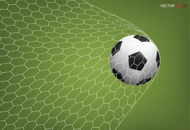 Pallone da calcio in porta e rete bianca