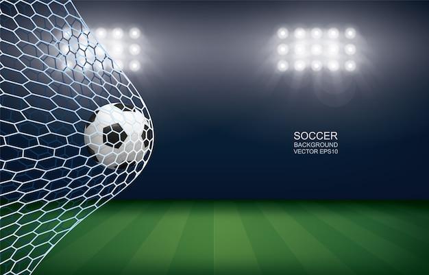 Sfera di calcio di calcio in porta con sfondo dello stadio.