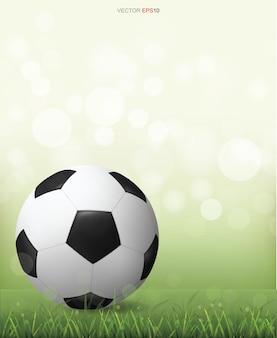 Pallone da calcio calcio sul campo di erba verde con sfondo bokeh sfocato luce. illustrazione vettoriale.