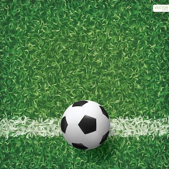 Pallone da calcio su erba verde del fondo del campo di calcio. illustrazione vettoriale.