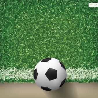 Pallone da calcio nel modello del campo di calcio e nel fondo di struttura. illustrazione vettoriale.