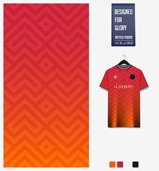 Modello astratto di disegno del modello del tessuto della maglia da calcio su sfondo arancione
