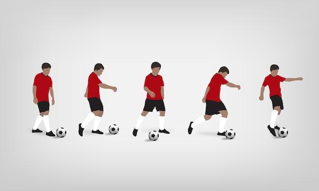 Calciatore che gioca e che dà dei calci al pallone da calcio su fondo bianco.
