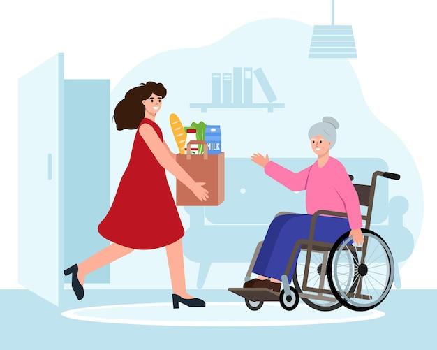 Assistenza sociale per gli anziani la ragazza aiuta la donna anziana o la nonna a fare la spesa a comprare cibo