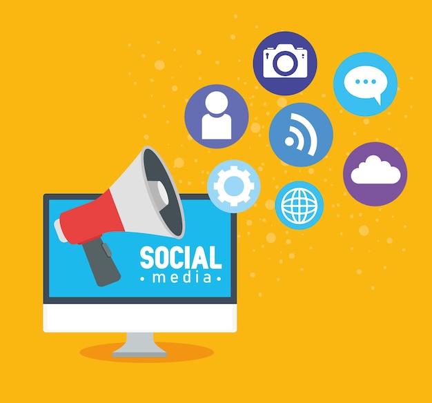 Concetto di social media, computer con megafono e icone illustrazione design