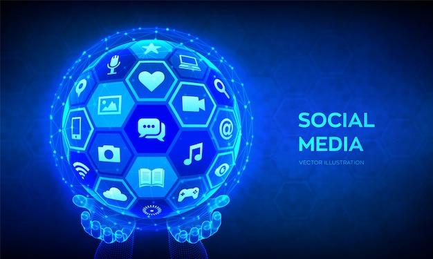 Concetto di connessione globale dei social media. sfera o globo astratta 3d con con icone di un social media in mani del wireframe.