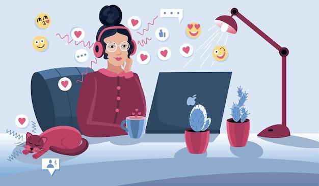 Social media manager o influencer al lavoro. ragazza carina seduta in poltrona comoda e navigare in internet sul suo computer portatile.
