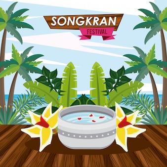 Celebrazione del songkran con acqua in ciotola