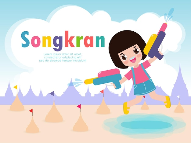 I bambini del festival di songkran con la pistola ad acqua si divertono a spruzzi d'acqua