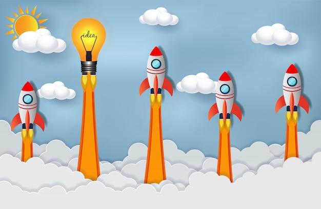 La navetta spaziale e la lampadina si lanciano verso il cielo in competizione per il successo.