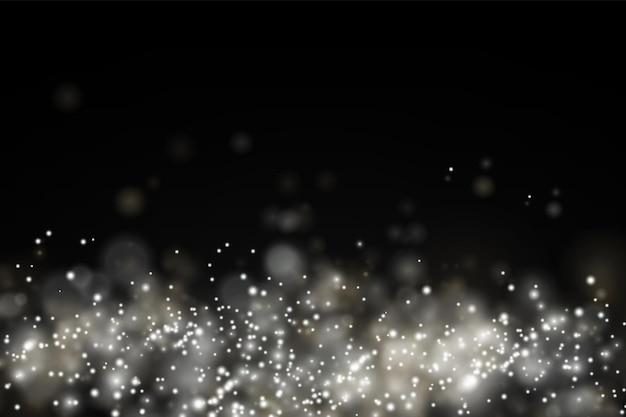 Particelle di polvere scintillanti bokeh natale scintilla effetto luce scintilla scintille bianche stella